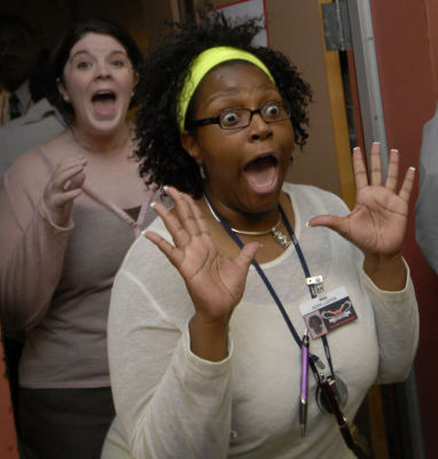 Social Studies teacher Chanda Jammal, front, and At-Risk Coordinator Hope Luster react joyfully upon hearing that Klein Intermediate School received a $3300 grant from InvesTex Credit Union for sewing machines which will allow increased participation in Skills for Living classesses and a  Sewing Club for students and staff members. Photo: Tony Bullard, For The Chronicle