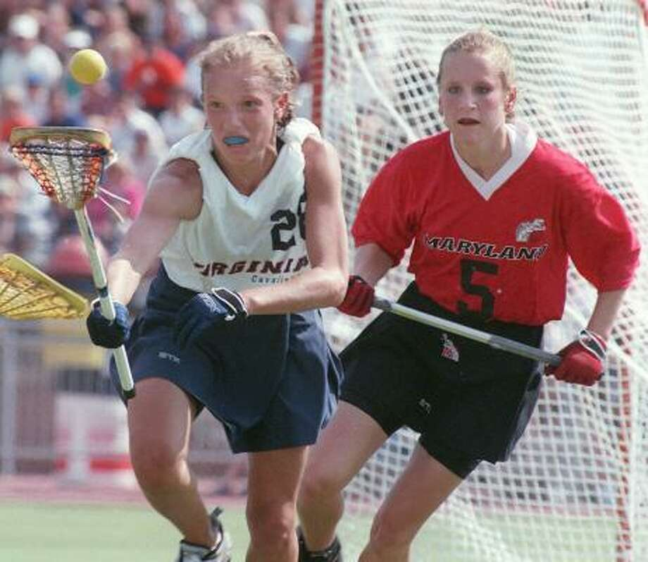Virginia takes on Maryland in lacrosse. Programs for women in sports such as lacrosse were hard to find before Title IX. Photo: JOHN GILLIS, AP