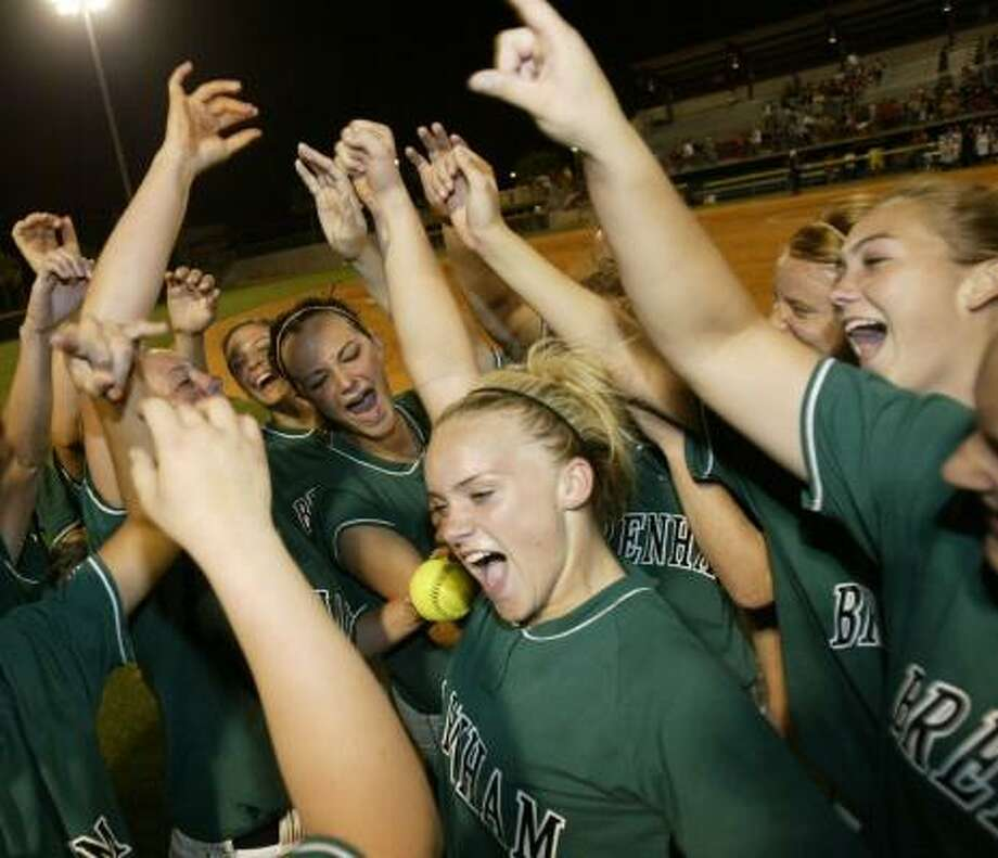 Brenham players celebrate after the Cubs sewed up their fifth consecutive trip to the state tournament. Photo: JESSICA KOURKOUNIS, FOR THE CHRONICLE