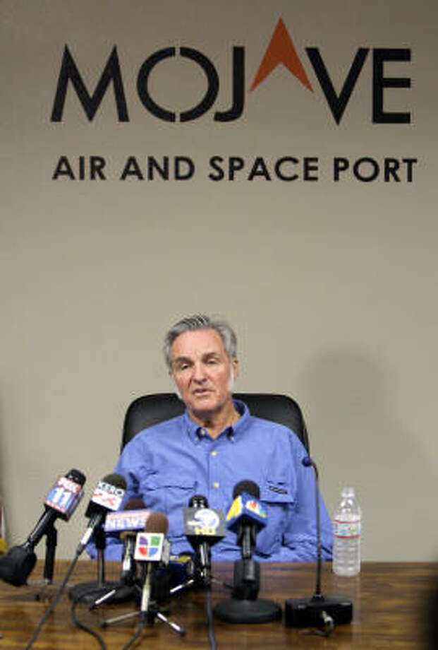 Aerospace designer Burt Rutan talks to reporters after the blast at a facility belonging to Scaled Composites. Photo: Mark J. Terrill, AP