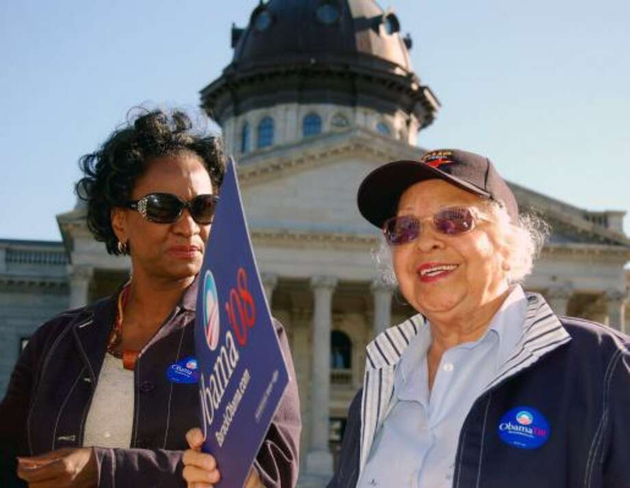 """""""I never thought I would see this day where I can come out here and let everybody know I'm for a black man,"""" Annie Bennett, 85, right, of Columbia, S.C., said at a recent Barack Obama rally. Photo: KEN HERMAN, COX WASHINGTON BUREAU"""