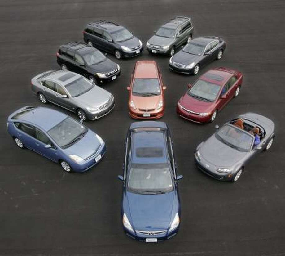 Consumer Reports' top picks for 2007 are, in the front row, Toyota Prius, Honda Accord, Mazda MX-5 Miata; center row: Infiniti M35, Honda Fit, Honda Civic; back row: Toyota RAV4, Toyota Sienna, Toyota Highlander and Infiniti G35. Photo: MARK LENNIHAN, ASSOCIATED PRESS