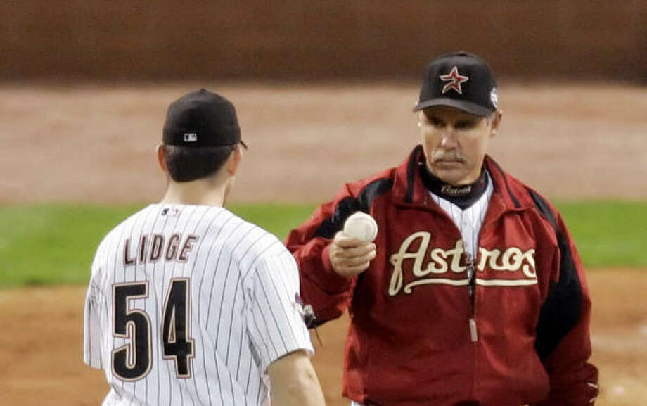 Astros manager Phil Garner, right, hopes his demotion of closer Brad Lidge stokes the pitcher's competitive fire. Photo: AMY SANCETTA, AP