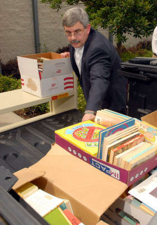 Humble Chamber of Commerce member Bruce Wise helps unload books donated to the Book Buddy community book drive benefitting area children. Photo: Dave Rossman, For The Chronicle