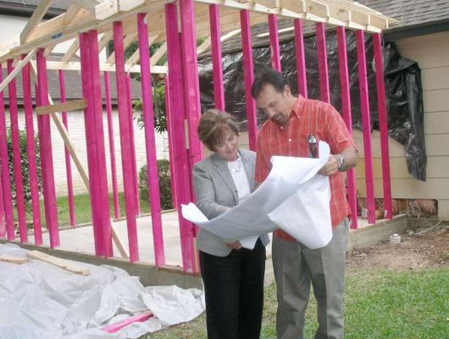 Jim Manfred, owner of J & M Construction & Remodeling goes over the plans for a bathroom addition with Kingwood homeowner Pat Dollar. Photo: Harry Williamson, For The Chronicle