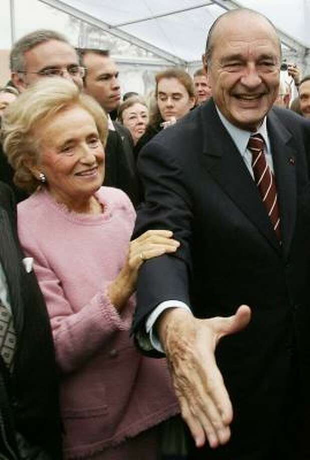 Bernadette Chirac, with her husband at a November ceremony, has another three years on her term as an elected regional councilor in central France. Photo: PATRICK KOVARIK, AFP/GETTY IMAGES