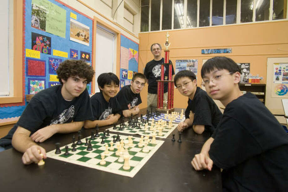 The T.H. Rogers Middle School's eighth-grade chess team was declared national champions at a recent U.S. Chess Federation tournament. Pictured are, from left, Matthew Michaelides, Ace Isidro, Matthew Resh, coach Evan Michaelides, Jeff Feng and Luke Zhu. Photo: R. Clayton McKee, For The Chronicle