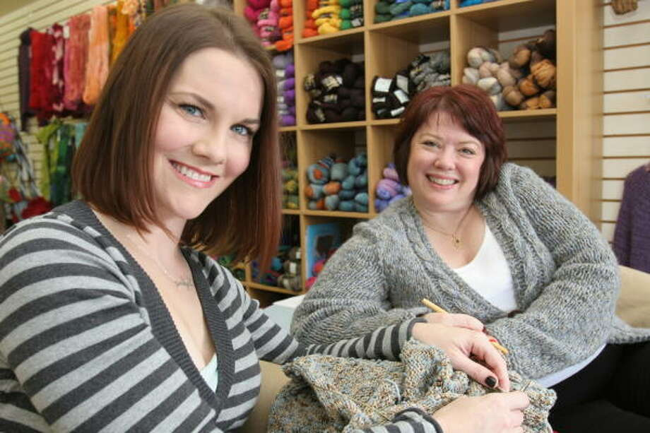Amy Tyer, 34, left, of Katy and Sheryl Means, 48, of Richmond own Yarntopia. The Katy-area store offers classes in crocheting and knitting. Photo: Suzanne Rehak, For The Chronicle