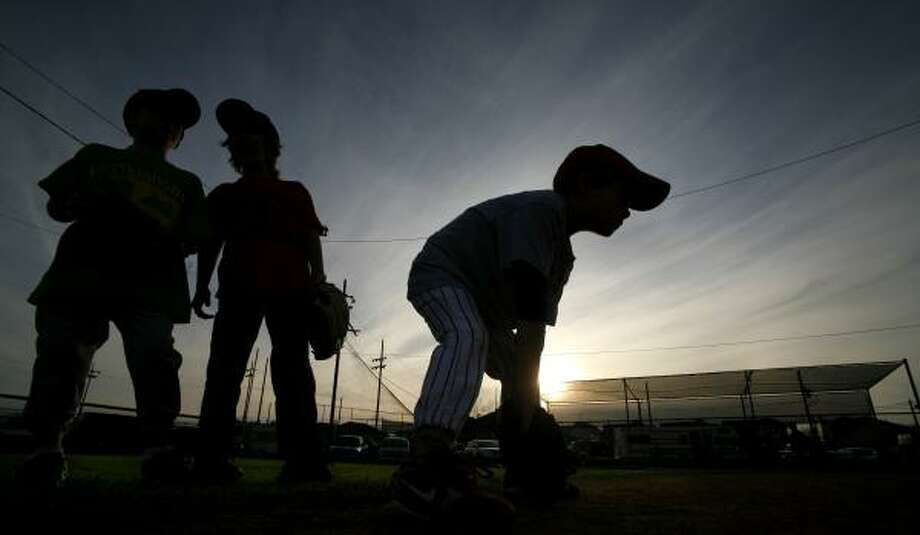 When daylight-saving time begins March 11, three weeks earlier than usual, Westbury Little League will gain playing time and save money, said league President Ted Freeman. Photo: STEVE UECKERT, CHRONICLE