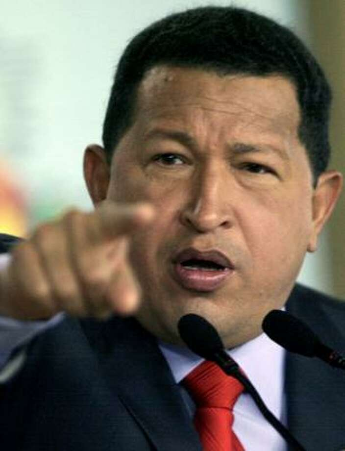 Venezuelan President Hugo Chavez's policy required Exxon Mobil to give up control of its Orinoco River basin operations. Photo: JUAN BARRETO, AFP/GETTY IMAGES