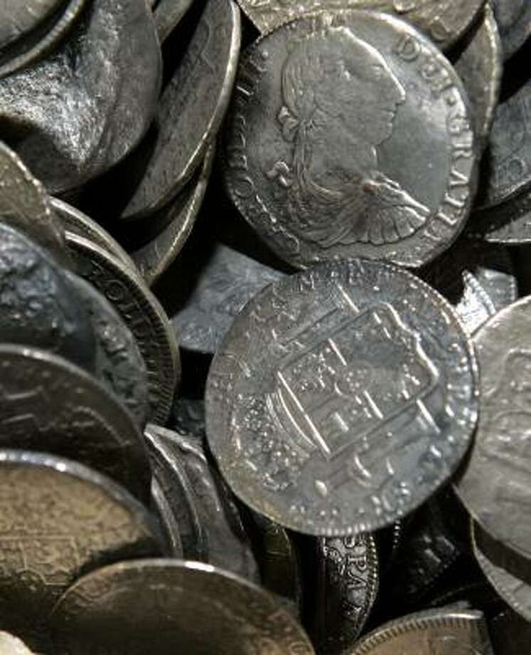 These coins were found on a ship that sank in 1784. Photo: FRANK FRANKLIN II, ASSOCIATED PRESS