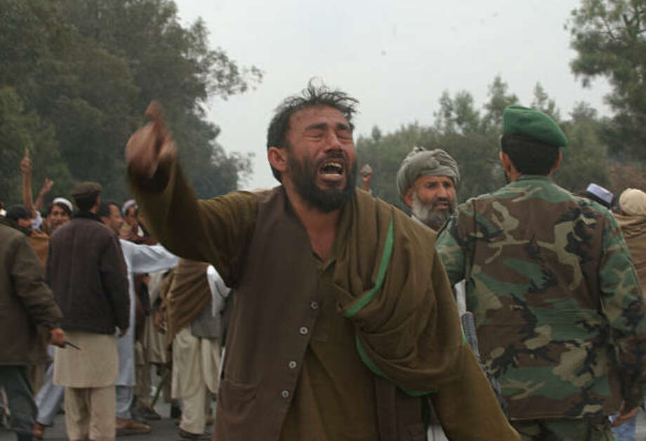 An Afghan man cries as he shouts anti-American slogans after a car bomber attacked an American convoy in Barayekab in Nangarhar province, eastern Afghanistan, in this March 4 file photo. A U.S. Marine unit broke international humanitarian law by using excessive force during a shooting spree last month that left 12 people dead, an Afghan human rights group said in a report Saturday. The troops shot indiscriminately at pedestrians, people in cars, public buses and taxis in six different locations along a 10-mile stretch of road in Nangahar province after an explosives-rigged minivan crashed into their convoy on March 4, according to the report. Photo: RAHMAT GUL, AP