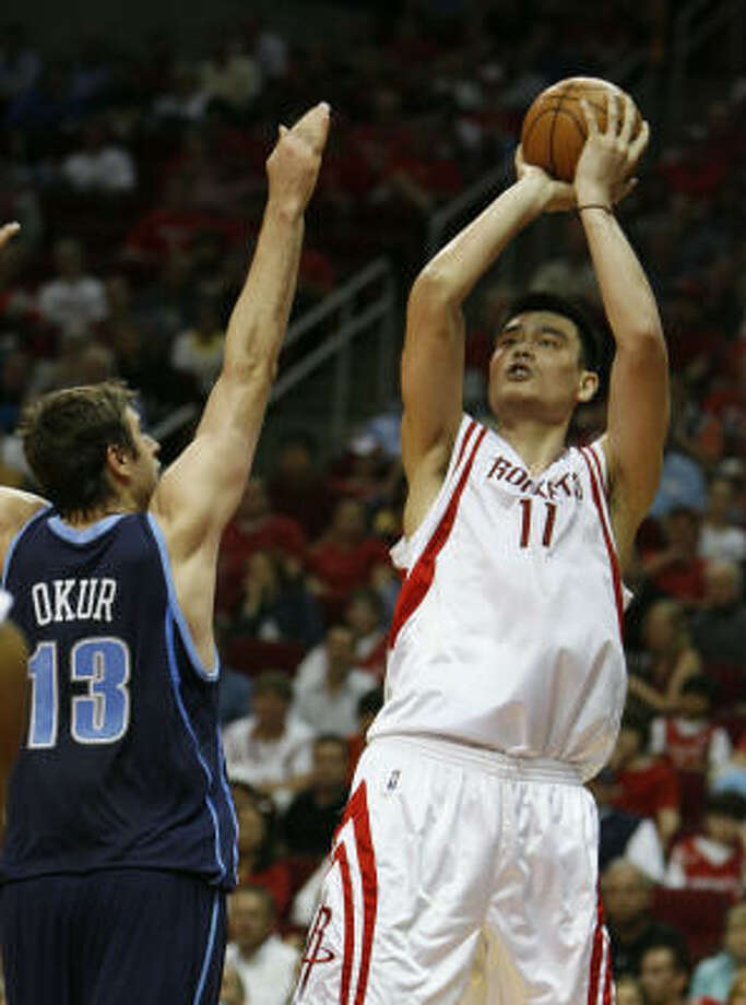 Yao Ming had 28 points to six for Jazz center Mehmut Okur. Photo: James Nielsen, Chronicle