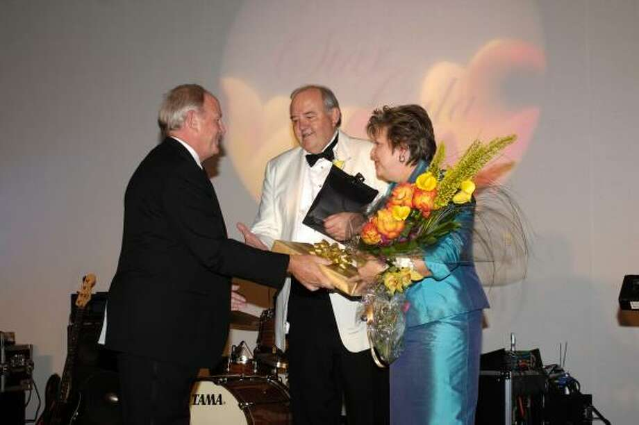 Foundation Board Chair, Stan St. Pierre, left thanks John Pickelman, and his wife Barbara, for 16 years of support for the NHMCCD Foundation at StarGala 2007. Pickelman will retire as chancellor of the college district in August. Photo: Courtesy Of NHMCCD
