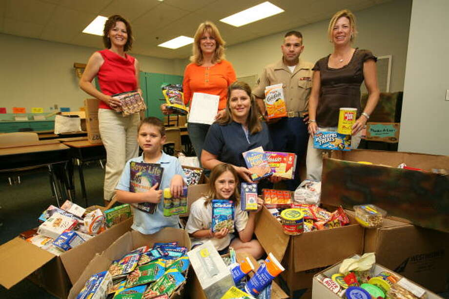Alexander Elementary PTA members and students will be sending needed items to the troops soon. From left, Cherie Heslop, Elizabeth Capel, Lisa Greer, Cpl. Homer Canales Jr. and Jill Diehl. In front, from left, Hunter Greer, 8, second-grader and his sister, Madeline Greer, 10, fourth-grader. Photo: Suzanne Rehak, For The Chronicle