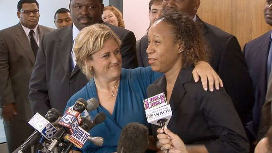 B.J. Bernstein, left, lawyer for Genarlow Wilson, embraces Wilson's mother, Juannessa Bennett, after learning that a state judge ordered Wilson released from prison. Prosecutors quickly appealed the decision, keeping Wilson behind bars for now. Photo: Jason Bronis, AP