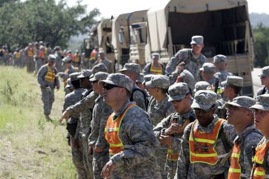 On June 12, soldiers set off on a search that found the body of Army Sgt. Lawrence Sprader, who disappeared June 8. Photo: TONY GUTIERREZ, ASSOCIATED PRESS FILE