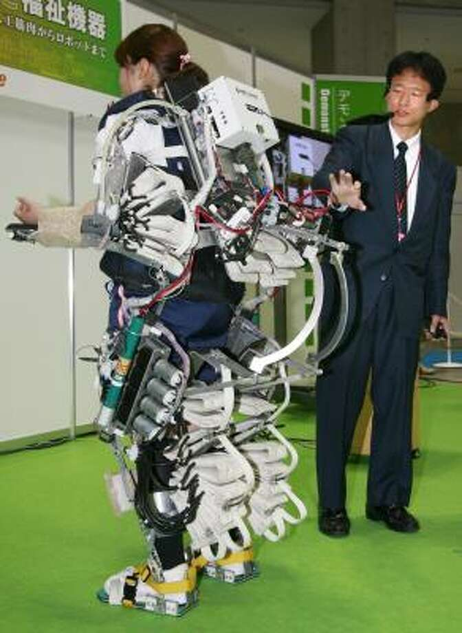 Kanagawa Institute of Technology researcher Mineo Ishii displays a power-assisted suit used to nurse the elderly and hospital patients. Ishii was demonstrating the suit, which uses air pressure, at a home care and rehabilitation exhibition in Tokyo this week. Photo: YOSHIKAZU TSUNO, AFP/GETTY IMAGES