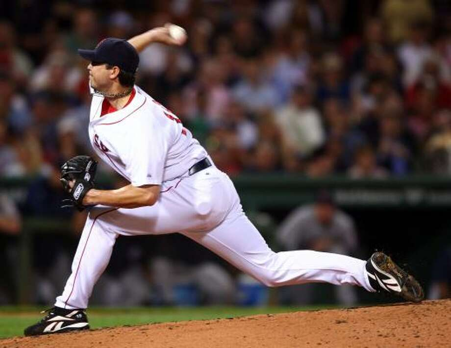 Boston's Josh Beckett faces off against Los Angeles' John Lackey in Game 1 of the teams' AL Division Series. Photo: Elsa, Getty Images