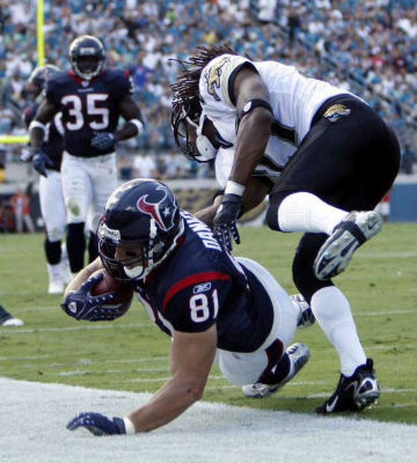 Texans tight end Owen Daniels (bottom) already has his next touchdown celebration planned. Photo: James Nielsen, Chronicle