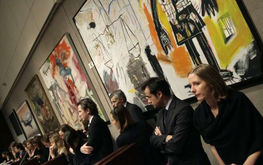 Christie's employees wait to take phone bids at a contemporary art auction in New York in November. Photo: SETH WENIG, ASSOCIATED PRESS FILE