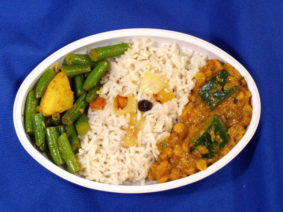 A Jyoti Indian Cuisine meal of chana dal (spiced split yellow peas) with green beans and basmati rice passes with flying colors. Photo: Vijai Gupta