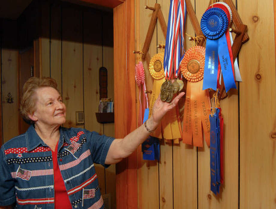 Mabel Helton displays some of the ribbons she has won at the county fair. She has other ribbons and trophies in storage at her home off FM 1488. Helton has entered the adult section of the Montgomery County Fair & Rodeo for the past 27 years. Photo: David Hopper, Or The Chronicle