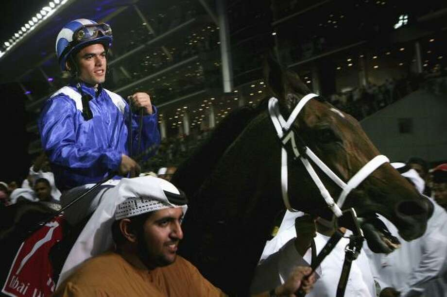 Jockey Fernando Jara rides Invasor to the winner's circle after claiming the Dubai World Cup on Saturday. Photo: CHRIS JACKSON, GETTY IMAGES