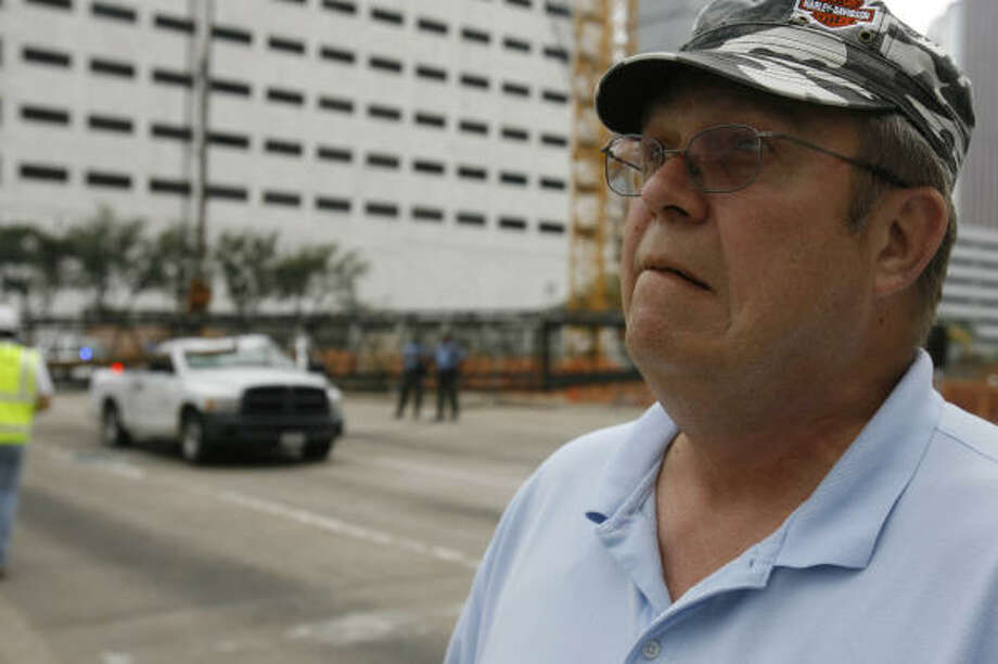 William Huther talks about being inside his truck that was hit by the boom of crane when it fell onto his truck on Friday. He was stopped at a traffic signal on San Jacinto between Dallas and Polk when the crane toppled. Photo: Melissa Phillip, Chronicle