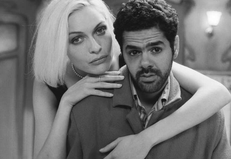A bad gambler (Jamel Debbouze) and his guardian angel (Rie Rasmussen) explore Paris in Angel-A. Photo: Sony Picture Classics