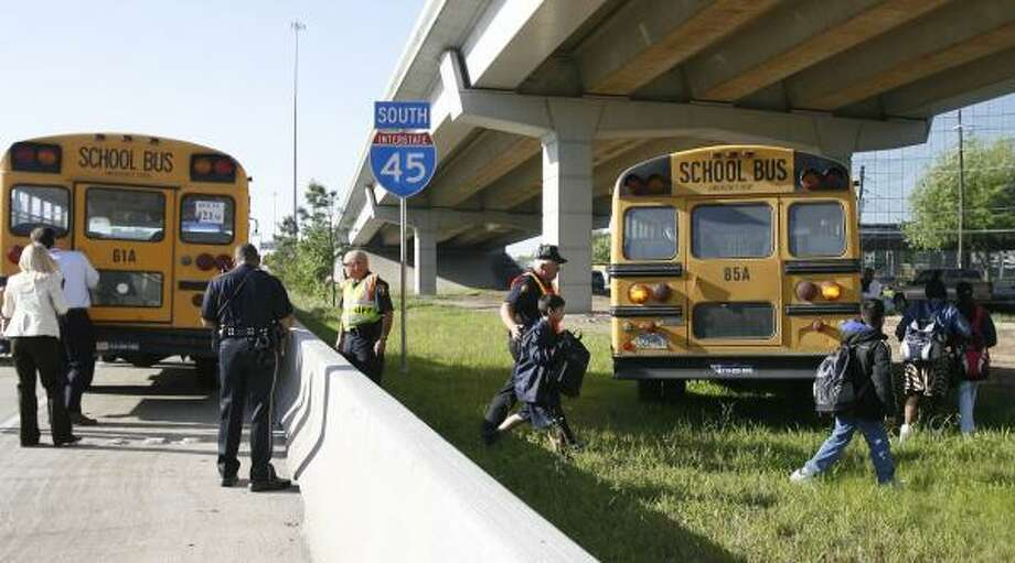 Students not injured in the crash were transferred to other buses. Photo: James Nielsen, Chronicle