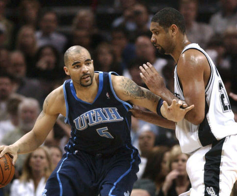 The last time Tim Duncan (21) saw the Utah Jazz in the playoffs the Spurs forward had to battle Karl Malone. Nine years later, Duncan will be going up against Carlos Boozer (5), who is a big reason Utah is in the Western Conference final, which begins Sunday at San Antonio. Photo: Gloria Ferniz, AP