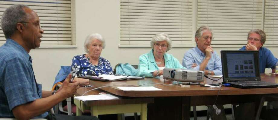 Baron's South Committee Co-Chairman Steve Daniels on Tuesday addresses RTM members, from left, Lois Schine, Velma Heller, Jonathan Cunitz and Matthew Mandell as the groups scrutinized plans for a seniors' health care and residential complex on town-owned Baron's South. Photo: Paul Schott / Westport News