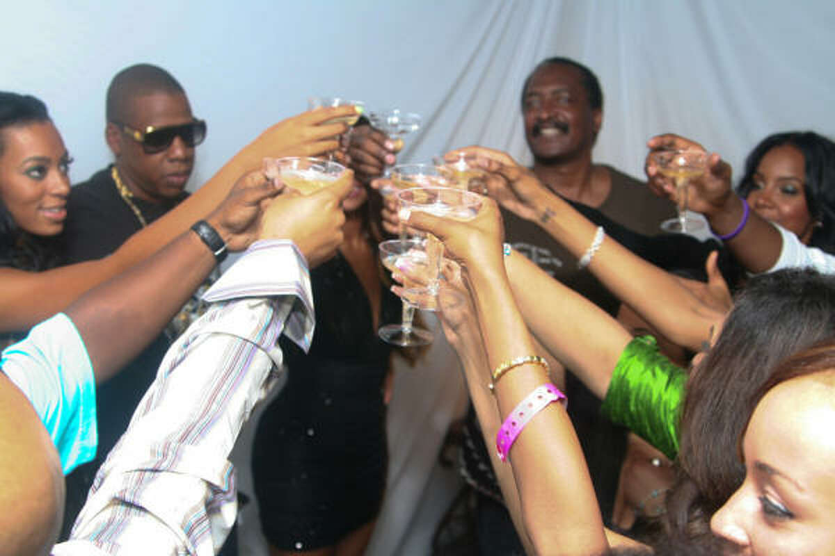 CHAMPAGNE TOAST: Family and friends raised their glasses in salute to Solange.