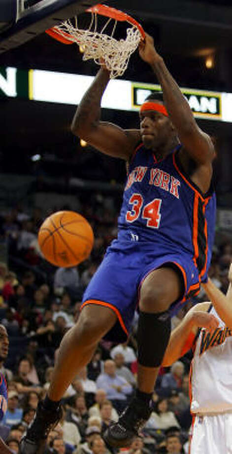 New York Knicks center Eddy Curry was robbed and held at gunpoint by three masked men on Saturday morning. Photo: MARCIO JOSE SANCHEZ, AP