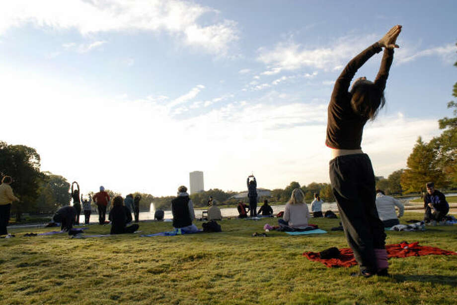 Yoga practicioners enjoy the green spaces at Hermann Park. Photo: Meenu Bhardwaj, For The Chronicle
