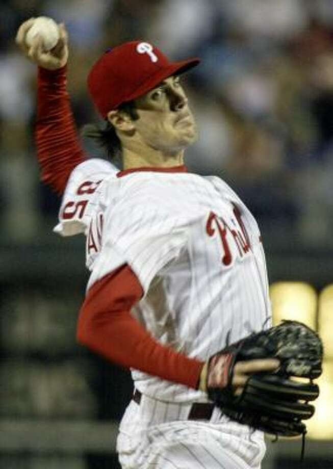 Cole Hamels struck out 13 in eight innings in leading the Phillies past the Nationals and into sole possession of first place in the NL East. Photo: H. RUMPH JR., AP