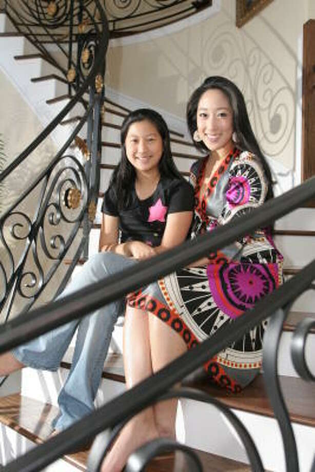 Andrea, 12, aspires to be Miss Korea Texas like her big sister Lynn Jo (right). Lynn Jo attended the Miss Korea competition in Seoul over the summer, where she won Miss Congeniality. Photo: Kenzie De La Torre, For The Chronicle