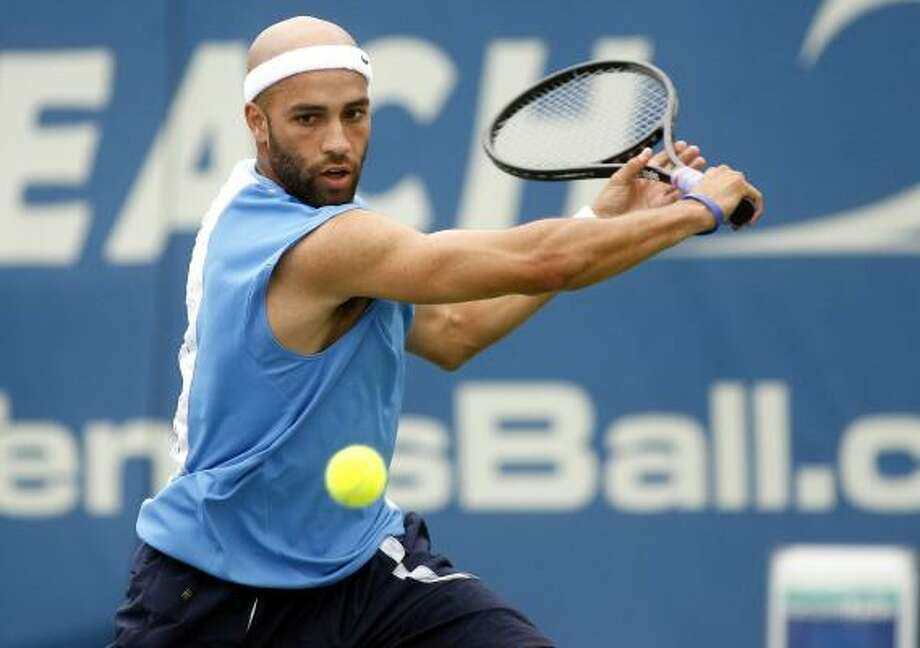 James Blake gets the jump on Xavier Malisse before the rain arrived in Florida. Photo: JON WAY, ASSOCIATED PRESS
