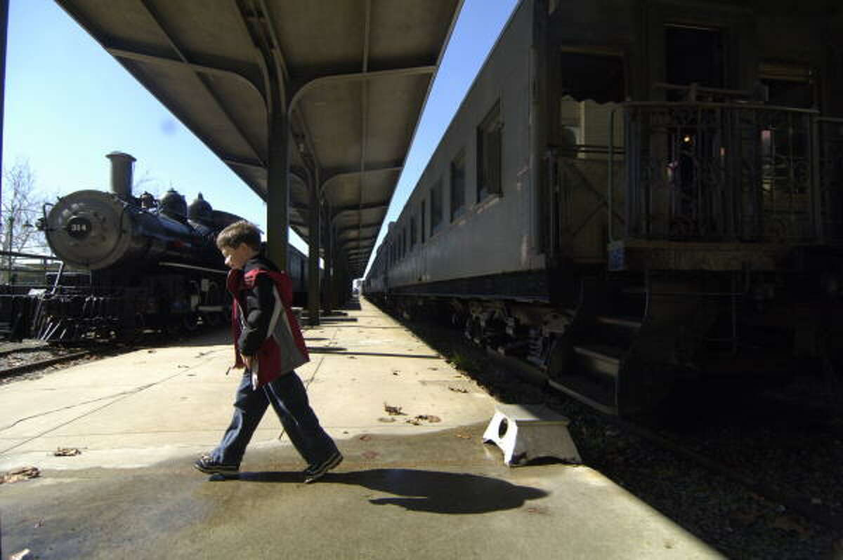 John Riordan, 8, of New Jersey, visits the railroad museum in Galveston, where the city is working on a blueprint for passenger service to Houston. Passengers from Houston would disembark at the museum, where they could catch a bus or trolley.