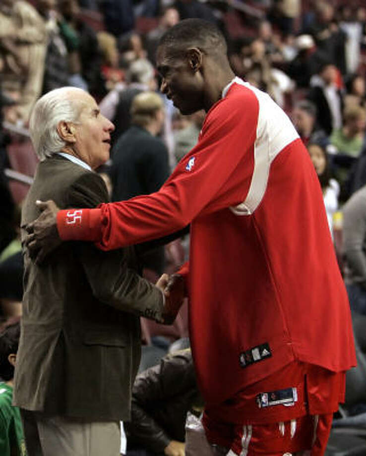 Dikemebe Mutombo isn't thanking 76ers chairman Ed Snider for the way his team gave up so many points on Sunday. Mutombo's an old friend, having played for Philadelphia for 1½ seasons. Photo: Tom Mihalek, AP