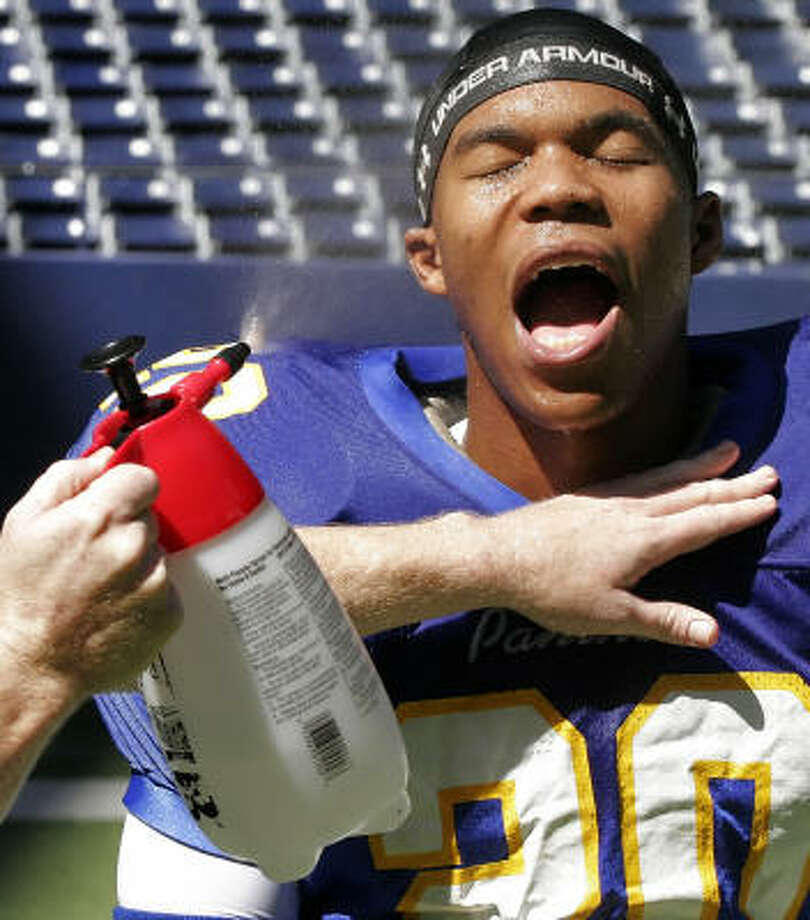 "Gaius Charles, who plays Brian ""Smash"" Williams on the show, gets a spray of water to simulate perspiration during filming at Texas Stadium, in Irving. Photo: Brandon Wade, For The Chronicle"
