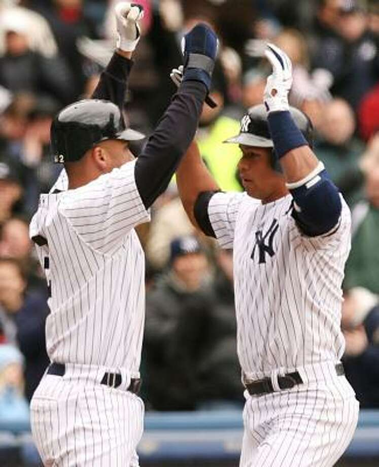 The Yankees franchise, with Derek Jeter, left, and Alex Rodriguez, is worth $1.2 billion, according to Forbes magazine. Photo: NICK LAHAM, GETTY IMAGES