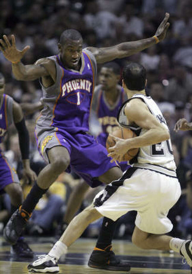 Manu Ginobili and the Spurs didn't get a field goal in the last 2:21 as Amare Stoudemire and the Suns evened their playoff series. Photo: LM Otero, AP