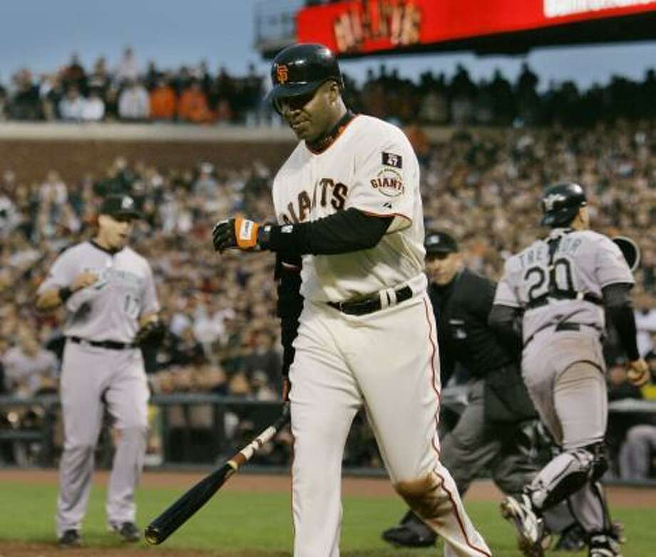 Barry Bonds leaves the plate empty-handed in the seventh, stranding a pair of Giants teammates. Photo: JEFF CHIU, ASSOCIATED PRESS