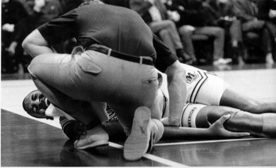 Injuries, including this one in 1990, and drug abuse help curtail the once-promising career of Roy Tarpley. Photo: Bill Janscha, AP
