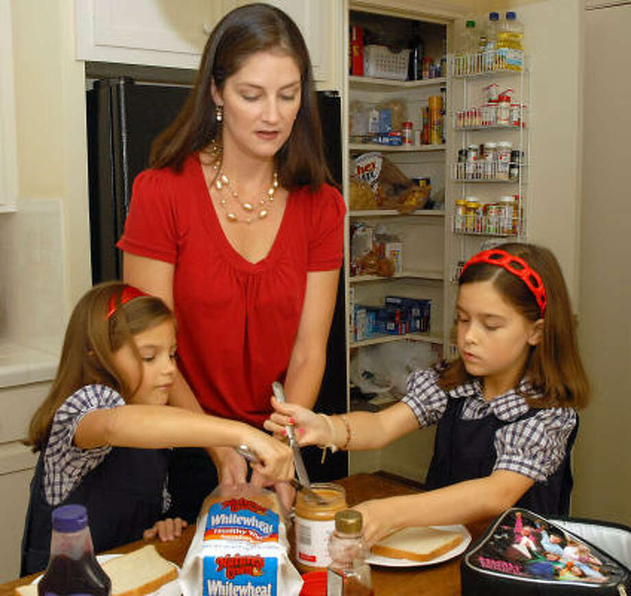 Rachel Ribbeck and her daughters Molly, 5, and Catherine, 7, try to make healthier choices when packing their school lunches. Photo: Dave Rossman, For The Chronicle