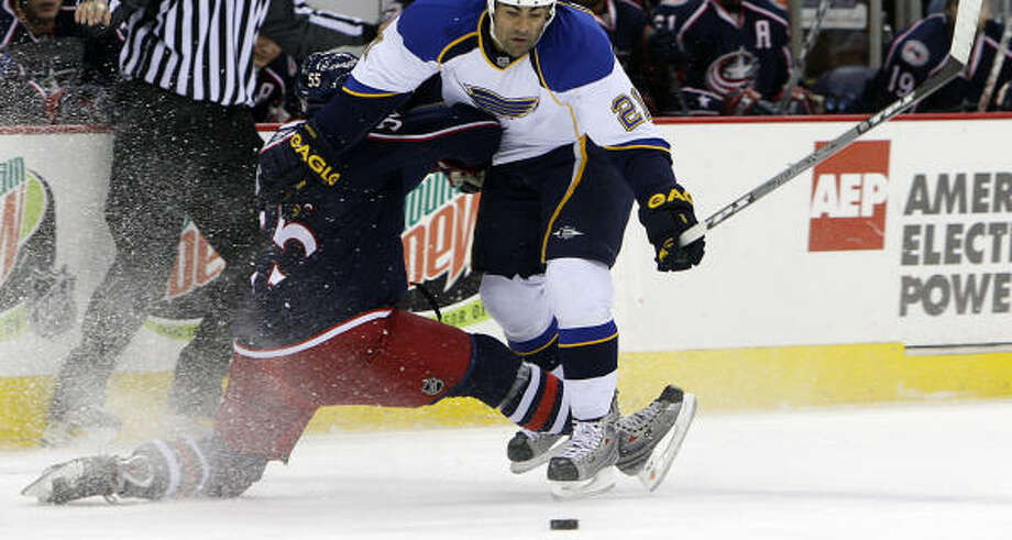St. Louis' Jamal Mayers moves in on the puck. His team lost back-to-back games for the first time this season. Photo: Jay LaPrete, AP
