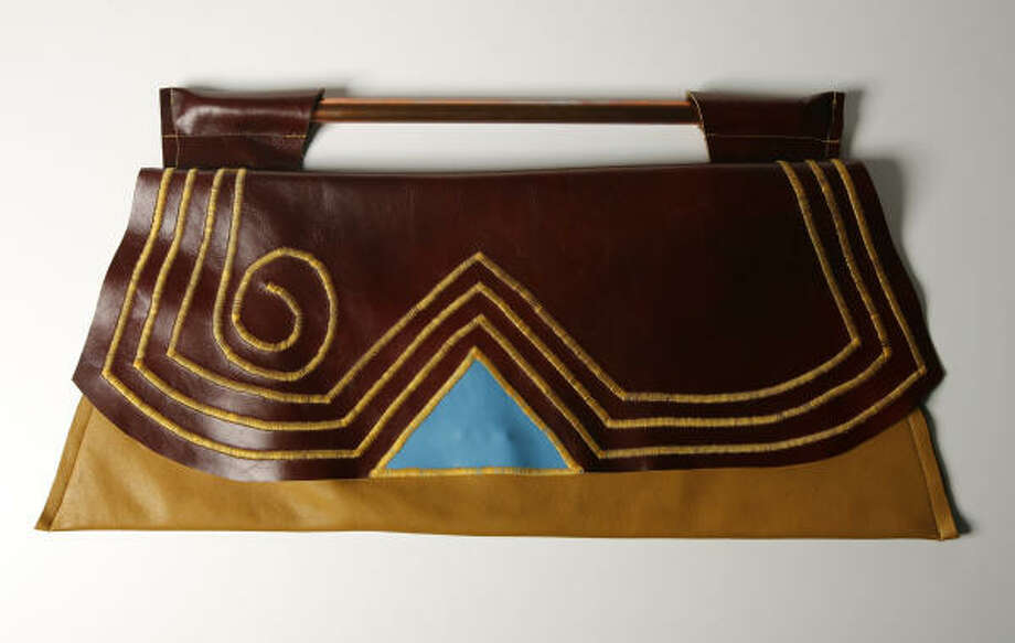 This leather clutch by Karmasoul International, $225, from Melodrama Boutique makes unique statement. Photo: Billy Smith II, Houston Chronicle