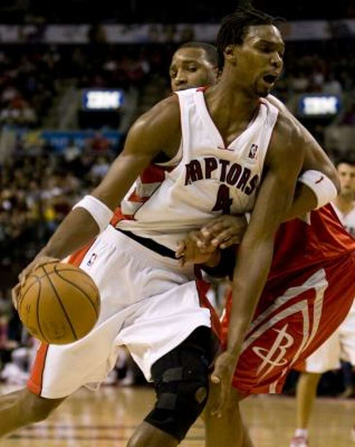 Chris Bosh led Toronto with 21 points in the win. Photo: Adrian Wyld, AP